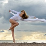 Beautiful ballerina is dancing at the beach