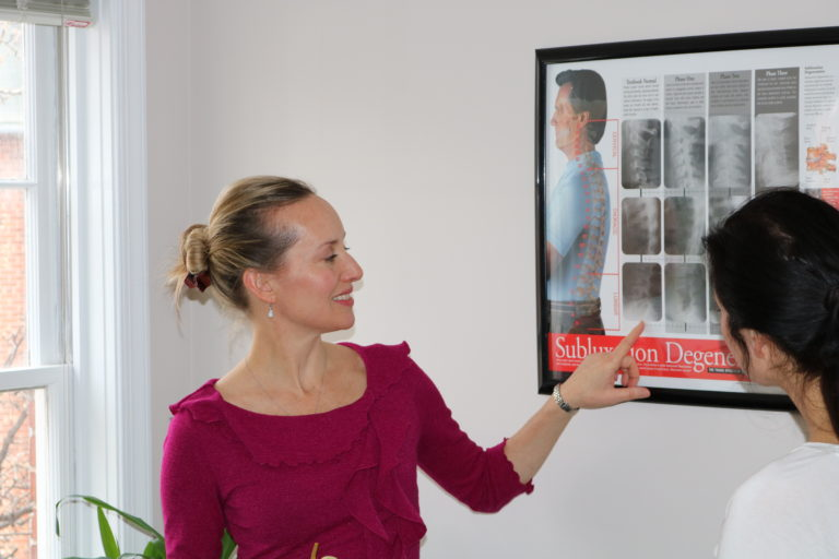 Frederick chiropractor educates patient about posture